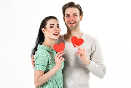 Valentines day and love. Romantic feelings concept. Man and woman couple in love hold red heart card on white background. Romantic couple in love hug. Handsome unshaven man and pretty girl in love Stock Photo - 137447101