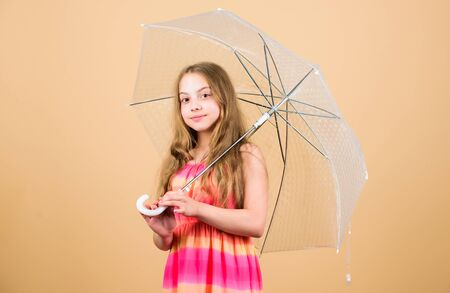 Happy little girl in autumn. autumn weather forecast. carefree childhood. autumn fashion. rainy weather. Fall mood. small girl with umbrella. Happy childhood
