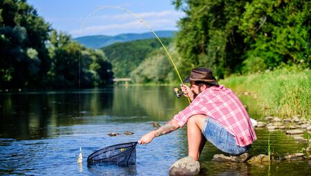 Hobby for soul. United with nature. Fisherman fishing technique use rod. Man catching fish. Guy fly fishing. Successful fly fishing. Man at riverside enjoy peaceful idyllic landscape while fishing.