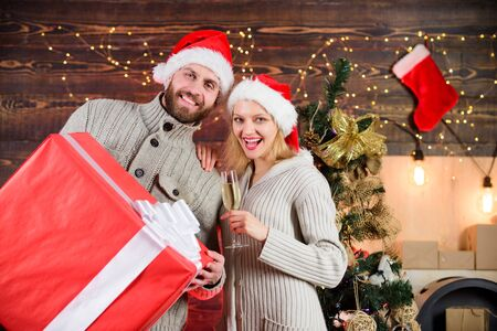 Romantic couple. family christmas party. winter season sales. woman and man love xmas. greeting time. Huge surprise. happy new year. Santa gift delivery. couple in love santa hat. Holiday presents