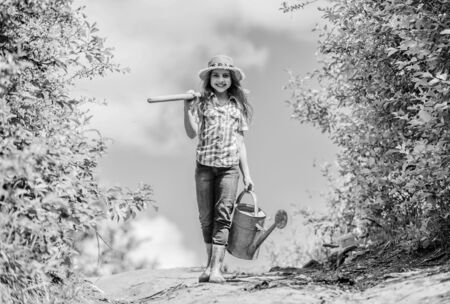 Spring gardening checklist. Little helper. Watering tools that will solve dry yard problems. Removable rose allows moderate flow. Gardening tips. Spring gardening. Girl child hold shovel watering can
