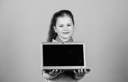 modern life with online shopping. child development with new technology. buy online on cyber Monday sales. happy small girl blogging on laptop. online courses. business communication. Helpful tool