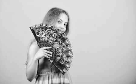 Folding fans. Acting school. Dances with fan. Girl fanning herself with fan. Air circulation. Art and culture. Handheld fan create airflow. Airflow from handfans increases evaporation. Cooling effect