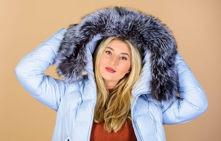 Finally winter comes. happy winter holidays. girl in puffed coat. faux fur fashion. flu and cold. seasonal fashion. beauty in winter clothing. cold season shopping. woman in padded warm coat