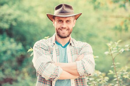 Eco farm worker. Harvest. farming and agriculture cultivation. Gardening ranch. happy earth day. Eco living. muscular ranch man in cowboy hat care plants. successful sexy farmer. Working with plants