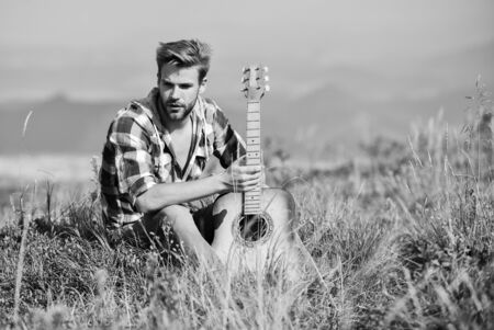 Let the Music Take You Away. western camping and hiking. cowboy man with acoustic guitar player. sexy man with guitar in checkered shirt. country music song. hipster fashion. happy and free