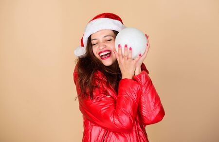 Santa girl. Fashion trend. Winter season of contrasts. Accessory for celebration. Christmas mood. Winter clothes. Woman wear down jacket. Warm and cozy. Girl wear winter jacket beige background
