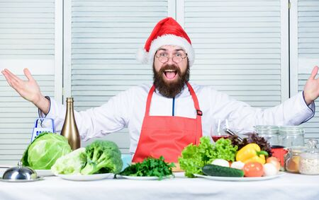 How make your christmas dinner healthier. How to enjoy holiday meals. Man bearded chef wear santa claus hat cooking. Responsibility cooking christmas dinner. Healthy christmas holiday recipes