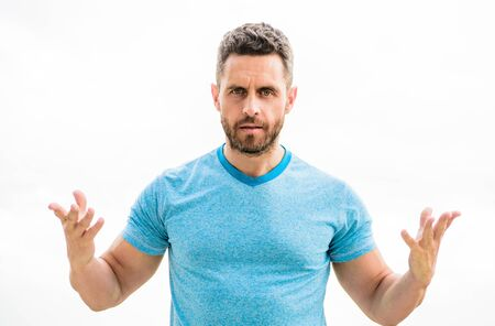 sportswear fashion. muscular male with beard. man isolated on white. sportsman with athletic body. coach in fitness gym. after workout. man athlete in blue sport tshirt. what is going on
