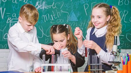 Focusing on work. Little children at laboratory. students doing biology experiments with microscope. Lab microscope. childrens day. Chemistry microscope. Little kids learning chemistry in school lab Stok Fotoğraf