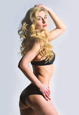 Fashion model with fit belly. Hair beauty of sensual girl. Perfect body shape. Sexy blond woman. Sexy woman with long curly hair. Epilation. Sensual female dance striptease
