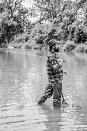 Fly fishing may well be considered most beautiful of all rural sports. Fisherman lucky catching fish. Good things come to those who bait. Fishing outdoor sport. Fishing hobby. Teach man to fish Reklamní fotografie