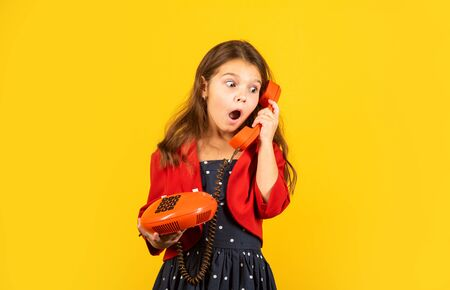 Little talker. Retro style. Communication concept. Shopping online. Retro girl speak phone. Kid talking vintage phone. Pinup girl conversation. Discuss gossip. Retro communications. Surprising news