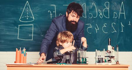 Pharmacy and chemistry theme. Wisdom. Back to school. son and father at school. solution in research laboratory. Genetic research. small boy with teacher man. School stuff Banque d'images