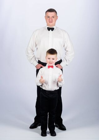 esthete. trust and values. male fashion. happy child with father. business meeting party. little boy with dad esthete businessman. family day. father and son in formal suit. tuxedo style. esthete.