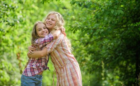 Girls children best friends hug. Sisterhood love and support. Happy childhood. Hug and love concept. Kids happy together nature background. True friendship. Girls smiling happy faces hug each other