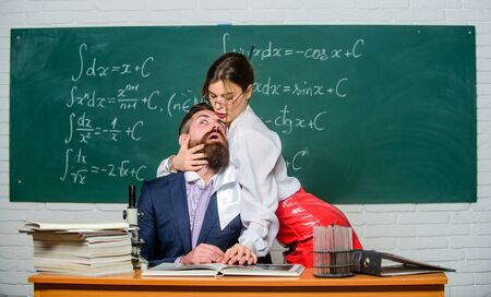 Sexual provocation. Provoke desire. Desirable girl cuddle man. Teaching with passion. Resist temptation. Sexual temptation at workplace. Victim of circumstances. Teacher student flirting