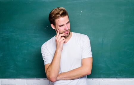 Happy teachers day. Master of simplification. Man teacher in front of chalkboard. Teaching could be more fun. Teacher interesting speaker lecturer. Advantages for male elementary teacher are abundant Stock Photo