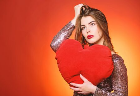 Romantic greeting. Be my valentine. Love and romance. Valentines day sales. Sensual girl with decorative heart. Sexy woman in glamour dress. Valentines day party. I love you. Life can not be better Banco de Imagens