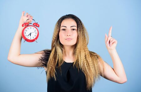 Time management. Woman hold vintage alarm clock. Watch repair. Punctuality and discipline. Practice of advancing clocks. Daylight saving time. Change time zone. Pretty girl managing her time
