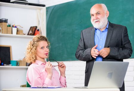 Work in education. Man mature school teacher and girl student with laptop. High school college university. Modern school. Communicate clearly and effectively. Lecturer educator sharing his knowledge