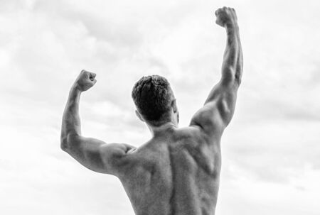 Victory and success. Champion and winner concept. Man celebrating success. Bodybuilder strong muscular body feeling powerful and superior rear view. Achieve success. Great shape. Successful athlete.