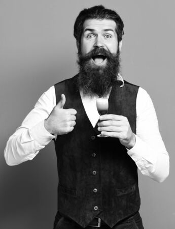 smiling handsome bearded man with long beard