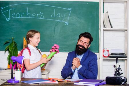 back to school. Happy teachers day. small school girl kid with flower bouquet. teachers day. Daugghter and father with flowers. knowledge day is 1 september. flower present for best teacher