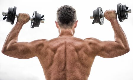 Sport lifestyle. Dumbbell exercise gym. Muscular man exercising with dumbbell rear view. Pain is temporary, pride is forever. Sportsman with strong back and arms. Sport equipment. Bodybuilding sport. Reklamní fotografie