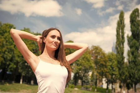 Training outdoors. Woman healthy body practice yoga outdoors nature background. Girl stretching workout. Stretching muscles. Yoga coach. Pilates fitness and weight loss. Stretching exercises 스톡 콘텐츠