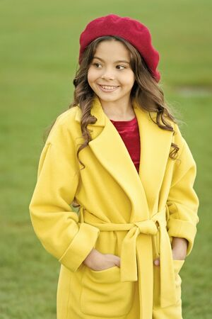 Feeling cozy and comfortable. Girl fashionable model wear yellow wool coat. Child in warm clothes. Fancy coat. Classic coat does not have to be boring but sticking to scale of warm, understated tones