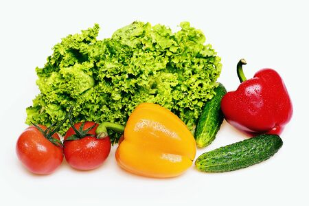 diet concept, peppers, leafy vegetables or green lettuce leaf with red tomatoes and cucumber isolated on white background