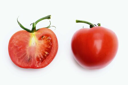 Healthy lifestyle concept. Tomatoes whole and half isolated on white background