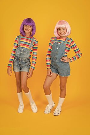 Anime fan. Cheerful friends in colorful wigs. Anime cosplay party concept. Animation style characterized colorful graphics vibrant characters fantastical themes. Anime convention. Happy little girls