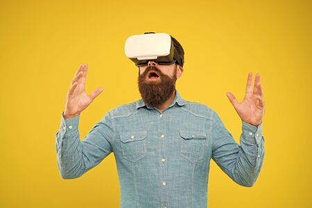 Cyber sport. Augmented reality. Enjoy game in 3D space. Game development. Digital technology. Living alternative life. Hipster play video game. Bearded man explore vr. Gamer concept. Gaming hobby. Stock Photo