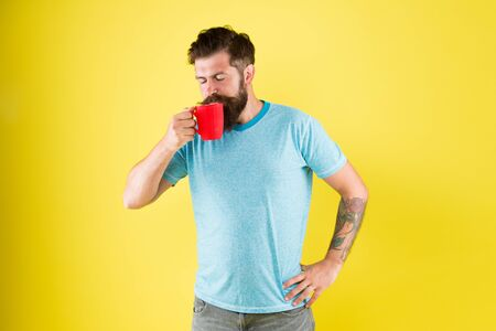 his perfect breakfast. Water balance and health care. Bearded man enjoy morning routine. sip of energy. brutal hipster drink beverage. hot drink mug. man casual style drink tea. good morning coffee