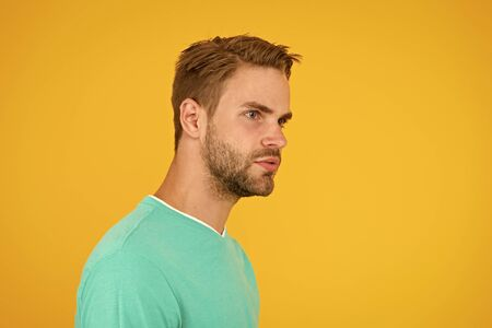 Barber hairdresser salon. Bearded man. Skin care. Facial care. Keep youth. Think about. Self care. Handsome man yellow background. Well groomed guy with bristle and nice hairstyle. Male beauty