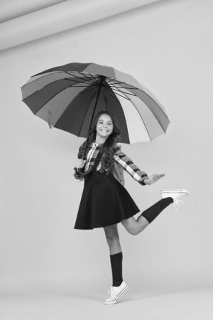 So beautiful. small girl colorful umbrella. bright autumn style. dancing on way to school. happy child protected rain. color up life. school time. good weather forecast. under my umbrella