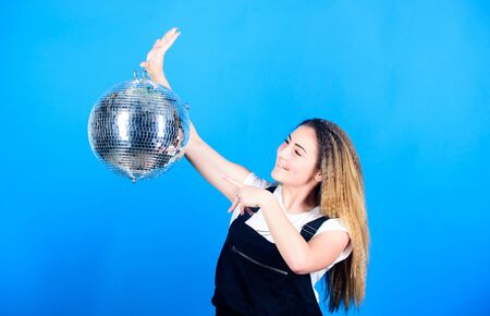 ready for having fun. happy birthday party. disco dancing. celebrating the holiday. girl with disco ball. party goer. lets dance. night life concept. christmas or new year holiday. Party time