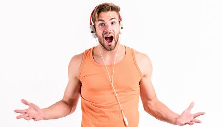 what is going on. sport music. joy and relax. sexy muscular man listen sport music. man in headset isolated on white. unshaven man in blue tooth headphones