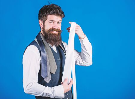 Happy with his choice. Sales manager offering a good choice of design neckties. Brutal hipster making a choice. Bearded man choosing tie from luxury collection. Choice concept, copy space