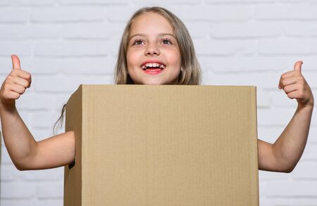Rent house. Real estate. Kid moving out. Moving routine. Prepare for moving. Make moving easier. Girl small child carry cardboard box. Packaging things. Move out concept. Delivering your purchase
