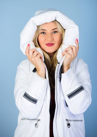 Fancy winter clothes. Not every jacket is ideal for every climate. Girl wear white jacket. Jacket has extra insulation and slightly longer fit in order to protect your body from sharp winter weather 版權商用圖片 - 138972468