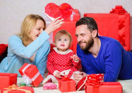Lovely family celebrating valentines day. Happy parents. Life can not be better. Family celebrate anniversary. Couple in love and baby daughter. Valentines day concept. Together on valentines day