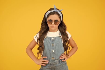 Fashion trend. You can have anything you want in life if dress for it. Little fashionista. Cute kid fashion girl. Summer fashion concept. Girl long curly hair wear sunglasses and fancy tied headscarf
