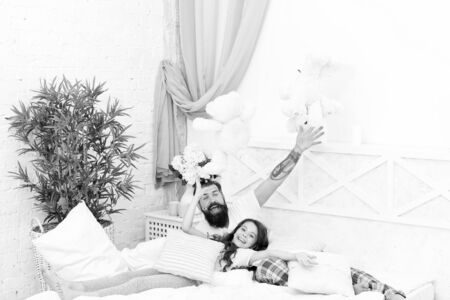 Free time. family bonding time. i love my daddy. happy morning together. good night. funny pajama party. small girl with bearded father in bed. weekend at home. father and daughter having fun