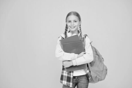 Teen with backpack and books. Motivated and diligent. Stylish schoolgirl. Girl little fashionable schoolgirl carry backpack. Schoolgirl daily life. School club. Modern education. Private schooling