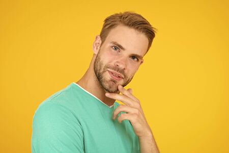 Think about. Self care. Handsome man yellow background. Well groomed guy with bristle and nice hairstyle. Male beauty. Barber hairdresser salon. Bearded man. Skin care. Facial care. Keep youth