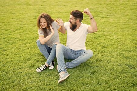 married couple do not get along with each other. divorce. woman afraid of her aggressive boyfriend. bearded man beating girlfriend. Violence and aggression. Couple suffer violence