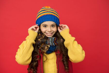 Fashion shop. Happy childhood. Winter fashion for kids. Happy winter holidays activity. Feeling warm and happy. Cheerful smiling hipster child long hair in stylish outfit. Winter ideas for fun Stock Photo